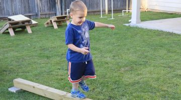 Child walking on a plank